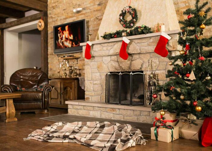 Indoor holiday decor with Christmas tree and fireplace